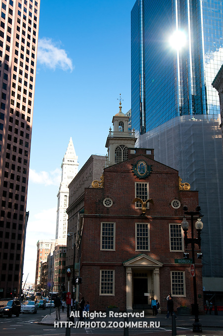 Old State House with skyscraper behind in Boston, MA