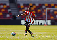 17th April 2021; Brentford Community Stadium, London, England; English Football League Championship Football, Brentford FC versus Millwall; Tariqe Fosu of Brentford passing the ball into midfield