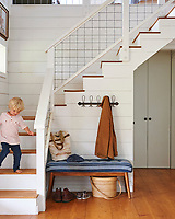 The stairwell railing is made from wire cattle panels from a farm store.