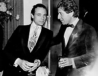 Wearing a tie about as subtle as CITY-TV, media mogul Moses Znaimer, above, chats with the inscrutable Leonard Cohen, who sported a sedate black tie with cowboy boots.<br /> Combs, Erin<br /> Picture, 1982<br /> <br /> <br /> Toronto Star Archives - AQP