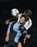 Joe Jacobson of Wycombe Wanderers and Matt Smith of Fulham go up for the ball during the Capital One Cup match between Wycombe Wanderers and Fulham at Adams Park, High Wycombe, England on 11 August 2015. Photo by Andy Rowland.