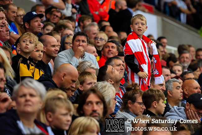 Stoke City 1 West Bromwich Albion 1, 24/09/2016. Bet365 Stadium, Premier League. A young Stoke fan watches the big screen. Photo by Paul Thompson.