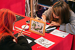 Visitors draw a traditional Japanese picture during the Moshi Moshi Nippon Festival 2016 on November 26, 2016 in Tokyo, Japan. Moshi Moshi Nippon Festival 2016 aims to promote Japanese pop culture (fashion, anime, technology, music and food) to the world, and non-Japanese visitors are able to enter the event for free by showing their passport. This year's two day event included live shows by Japanese pop stars Silent Siren, Dempagumi.inc, Tempura Kids, Capsule and Kyary Pamyu Pamyu at the Tokyo Metropolitan Gymnasium. (Photo by Rodrigo Reyes Marin/AFLO)