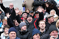ATTENTION SPORTS PICTURE DESK<br /> Pictured: Fans of Swansea City in action<br /> Re: Coca Cola Championship, Swansea City Football Club v Newcastle United at the Liberty Stadium, Swansea, south Wales. 13 February 2010
