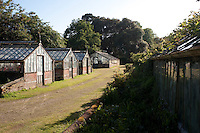 Rows of greenhouses in an area of the garden are used to propagate plants destined for the house