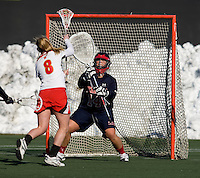 Kristy Black (8) of Maryland shoots past Erica Marrocco (14) for a goal at the practice turf field in College Park, Maryland.  Maryland defeated Richmond, 17-7.