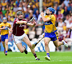 Shane O Donnell of Clare in action against Joseph Cooney of Galway during their All-Ireland semi-final replay at Semple Stadium,Thurles. Photograph by John Kelly.
