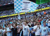 28th May 2018, Wembley Stadium, London, England;  EFL League 2 football, playoff final, Coventry City versus Exeter City; Coventry City fan waving a Coventry City flag after Jack Grimmer of Coventry City  scores his sides 3rd goal in the 68th minute to make it 3-0