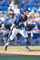 Asheville Tourists Cade Harris (4) starts down the first base line against the Columbia Fireflies at McCormick Field on June 22, 2019 in Asheville, North Carolina. The Tourists defeated the Fireflies 6-5. (Tony Farlow/Four Seam Images)