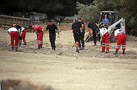 Pictured: Forensics officers and Red Cross volunteers go through soil at the farmhouse site, where Ben Needham disappeared from in Kos, Greece. Wednesday 12 October 2016<br />Re: Police teams led by South Yorkshire Police are searching for missing toddler Ben Needham on the Greek island of Kos.<br />Ben, from Sheffield, was 21 months old when he disappeared on 24 July 1991 during a family holiday.<br />Digging has begun at a new site after a fresh line of inquiry suggested he could have been crushed by a digger.