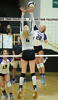 Fayetteville's Brooke Rockwell (20) sends the ball over the net Tuesday, Sept. 15, 2020, as Bentonville's Gloria Cranney (6) defends during play in Tiger Arena in Bentonville. Visit nwaonline.com/200916Daily/ for today's photo gallery. <br /> (NWA Democrat-Gazette/Andy Shupe)