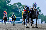 July 17, 2021: Mandaloun, #3, ridden by jockey Florent Geroux are declared the winners of the  Grade 1 Haskell Invitational after the unofficial winner #4 Hot Rod Charlie and jockey Flavien Prat are disqualified and placed last after interference in the stretch at Monmouth Park Racecourse in Oceanport, New Jersey on July 17, 2021. Scott Serio/Eclipse Sportswire/CSM