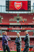 ( L-R ) Tony Roberts, Swansea City Goalkeeping Coach, Bob Bradley, Manager of Swansea City  and Swansea City fitness coach, Pierre Barrieu look on prior to the Premier League match between Arsenal and Swansea City at Emirates Stadium on October 15, 2016 in London, England.