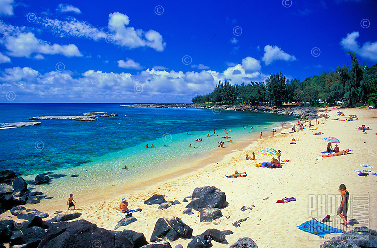 """Pupukea Beach Park is a snorkelers and scuba divers paradise as well as a great spot to hang out in the warm Hawaiian sun. This north section of the  beach park is know as """""""" Three Tables"""""""" for it's three coral outcroppings that become more prominen"""
