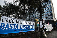 Rome, 09/12/2020. Today, members of Coordinamento Cittadino Lotta Per La Casa (Housing Rights Movement of Rome, 1.), including families, attended a demonstration held outside the HQ of ACEA (Azienda Comunale Energia e Ambiente, Municipal Energy and Environment Agency) to protest against the alleged disconnection of water and electricity in concurrence with the evictions of housing/residential occupations. From the organisers press release: «[…] During the same hours in which a military attack against the Cinema Palazzo [2.] was launched, in many residential occupation of the city there were many checks of Acea workers and officials who, often without explanation and, sometimes, even with arrogance, tried to reach water/electricity meters, according to them, to carry out checks on behalf of the Company and the Prefecture […]. This operation, and its timing, have created great alarm among inhabitants of the occupations, certainly worried that the utilities could be disconnected, and therefore to remain without water and electricity in the midst of a serious social and health crisis [pandemic Covid-19 / Coronavirus] […]». On the 12 and 13 June 2011, in Italy was held a Referendum concerning a law which allowed to privatise and profit on water services. About 95,80% of the Italian people who went to vote rejected that law (3.). <br /> <br /> Footnotes & Links:<br /> 1. http://bit.do/fLLKn<br /> 2. 25.11.2020 Demo And Clashes Against Nuovo Cinema Palazzo Eviction in Rome's San Lorenzo: http://bit.do/fLxgz <br /> 3. https://en.wikipedia.org/wiki/2011_Italian_referendums
