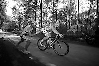 André Greipel (DEU) has a flat after a very dangerous descent full of putholes. Teammate Frederik Willems (BEL) stops to give up his wheel and with the teamcar still far behind, it's DIY-time for the riders.<br /> <br /> 2013 Ster ZLM Tour <br /> stage 4: Verviers - La Gileppe (186km)