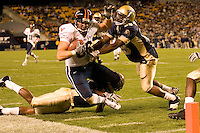 Virginia Cavaliers Tight End Tom Santi gets pushed out of bounds just short of the goal line by Pitt Panthers defensive back Eric Thatcher.  The Panthers defeated the Cavaliers 38-13 in the game played on September 02, 2006 at Heinz Field in Pittsburgh, Pennsylvania.