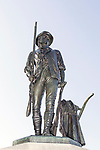 """On the 100th anniversary of the """"Shot heard around the World"""" in Concord, Massachusetts, a memorial statue of a Minuteman waas erected to commemorate this historic moment in American history.  This Minuteman was a farmer, or businessman who picked-up arms against the British to win their independence."""