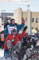 Sarah Stokey and team leave the ceremonial start line with an Iditarider at 4th Avenue and D street in downtown Anchorage, Alaska on Saturday March 2nd during the 2019 Iditarod race. Photo by Brendan Smith/SchultzPhoto.com