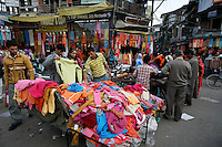 Shoppers examine colorful clothes at a market in central Srinagar, Kashmir,India. © Fredrik Naumann/Felix Features