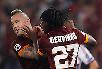 Calcio, Champions League, Gruppo E: Roma vs Bayern Monaco. Roma, stadio Olimpico, 21 ottobre 2014.<br /> Roma's Gervinho celebrates with teammate Radja Nainggolan, left, after scoring during the Group E Champions League football match between AS Roma and Bayern at Rome's Olympic stadium, 21 October 2014.<br /> UPDATE IMAGES PRESS/Isabella Bonotto