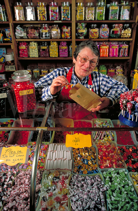 co-owner of store behind candy counter. Virginia Logan. Lexington Michigan USA downtown.
