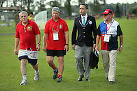 Pictured: Guinness World Record adjudicator Jack Brockbank (3rd L) with Mark Marriott (2nd L) and other organisers in Cardiff, Wales, UK. Wednesday 24 August 2016<br />Re: The largest rugby scrum has been achieved by Golden Oldies at University Fields in Cardiff south Wales, UK. It was refereed by welsh international referee Nigel Owens. Guinness World Records has verified the new record in which 1297 people took part in.