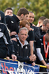 Assistant Coach Alan Curtis with Swansea City Football Club players and staff celebrating their promotion to the Premier League with an opentop bus tour of the city, where thousands of supporters turned out to show their appreciation..