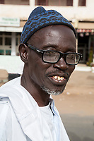 """Senegal, Touba.  A Local Imam.  """"My voice is much more beautiful than my face,"""" he said."""