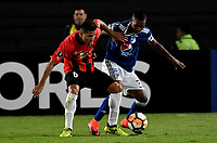 BOGOTA - COLOMBIA – 17 - 04 - 2018: Juan Salazar (Der.) jugador de Millonarios (COL), disputa el balon con Daniel Carrillo (Izq.) jugador de Deportivo Lara (VEN), durante partido entre Millonarios (COL) y Deportivo Lara (VEN), de la fase de grupos, grupo G, fecha 3 de la Copa Conmebol Libertadores 2018, en el estadio Nemesio Camacho El Campin, de la ciudad de Bogota. / Juan Salazar (R) player of Millonarios (COL), figths for the ball with Daniel Carrillo (L) player of Deportivo Lara (VEN), during a match between Millonarios (COL) and Deportivo Lara (VEN), of the group stage, group G, 3rd date for the Conmebol Copa Libertadores 2018 in the Nemesio Camacho El Campin stadium in Bogota city. VizzorImage / Luis Ramirez / Staff.