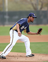 Yovani Gallardo #49 of the Milwaukee Brewers participates in pitchers fielding practice during spring training workouts at the Brewers complex on February 18, 2011  in Phoenix, Arizona..Photo by Bill Mitchell / Four Seam Images.