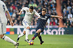 Carlos Henrique Casemiro (l) of Real Madrid competes for the ball with Ignacio Camacho Barnola of Malaga CF during their La Liga 2016-17 match between Real Madrid and Malaga CF at the Estadio Santiago Bernabéu on 21 January 2017 in Madrid, Spain. Photo by Diego Gonzalez Souto / Power Sport Images