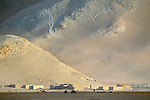 The austerity of the landscape of the Pamir Plateau is magnified by the quality of the light on this desolate region, Himalaya Range, China.