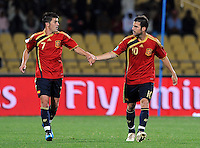 Cesc Fabregas (10) of Spain is congratulated by team-mate David Villa (7) after scoring his side's fourth goal. Spain defeated New Zealand 5-0 during the FIFA Conferderations Cups at Royal Bafokeng Stadium, in Rustenburg South Africa on June 14, 2009.