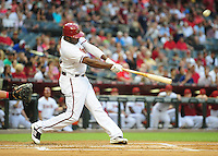 Apr. 23, 2012; Phoenix, AZ, USA; Arizona Diamondbacks outfielder Justin Upton hits a sacrifice fly ball in the first inning against the Philadelphia Phillies at Chase Field. Mandatory Credit: Mark J. Rebilas-