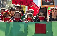 MANIFESTATION HAUSSE DES DROITS DE SCOLARITE ETUDIANTS GREVE<br /> RUE SAINTE-CATHERINE  A MONTREAL<br /> CARRE ROUGE SUR LA BOUCHE<br /> PHOTO JACQUES NADEAU<br /> 2 FEVRIER 2013 P.G-1<br /> HAUSSE DES DROITS DE SCOLARITE CONFLIT ETUDIANT CRISE GREVE<br /> 11 FEVRIER 2017 P.A-4 + TABLETTE