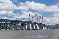 Tower cranes work to complete the cable towers on New Tappan Zee Bridge over the Hudson River between Westchester and Rockland counties.