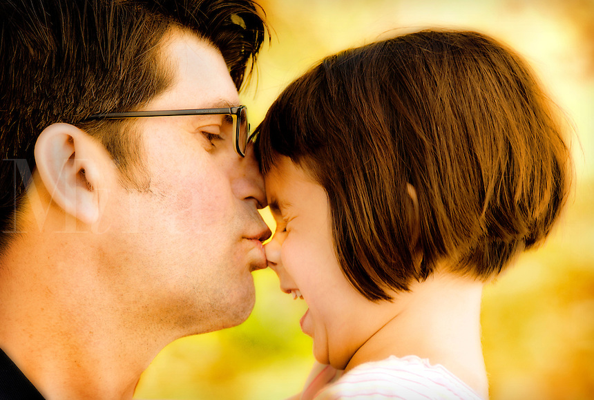 Father daughter kiss.