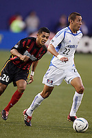 The  MetroStars' Amado Guevara chases the  Wizard's Davy Arnaud.  The Kansas City Wizards were defeated by  the NY/NJ MetroStars to a 1 to 0 at Giant's Stadium, East Rutherford, NJ, on May 30, 2004.