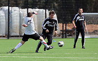 Thursday 11 April 2013<br /> Pictured L-R: South Wales Evening Post sports reporter Gareth Vincent attempts to tackle Michael Laudrup.<br /> Re: Friendly game, Swansea City FC coaching staff v sports reporters at the Swansea City FC training ground. Final score 10-4.