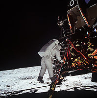 Buzz Aldrin steps out and descends to the surface of the Moon.