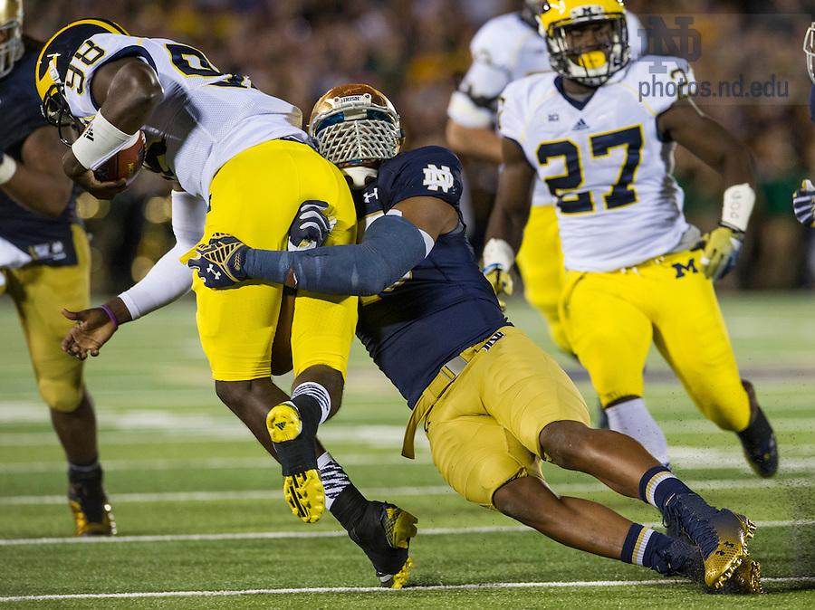 Sept. 6, 2014; Irish defensive lineman Romeo Okwara sacks Michigan quarterback Devin Gardner in the first half. (Photo by Barbara Johnston/ University of Notre Dame)