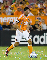 Houston Dynamo forward Brian Ching (25) advances the ball.  Houston Dynamo defeated D.C. United 4-3 at Robertson Stadium in Houston, TX on August 1, 2009.