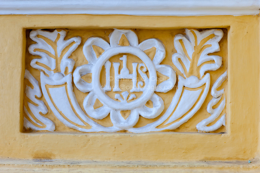 Antigua, Guatemala.  IHS  Decoration on Facade of La Merced Church, completed 1767.