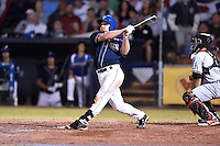 Asheville Tourists designated hitter Shane Hoelscher (22) swings at a pitch during game 3 of the South Atlantic League Championship Series between the Asheville Tourists and the Hickory Crawdads on September 17, 2015 in Asheville, North Carolina. The Crawdads defeated the Tourists 5-1 to win the championship. (Tony Farlow/Four Seam Images)