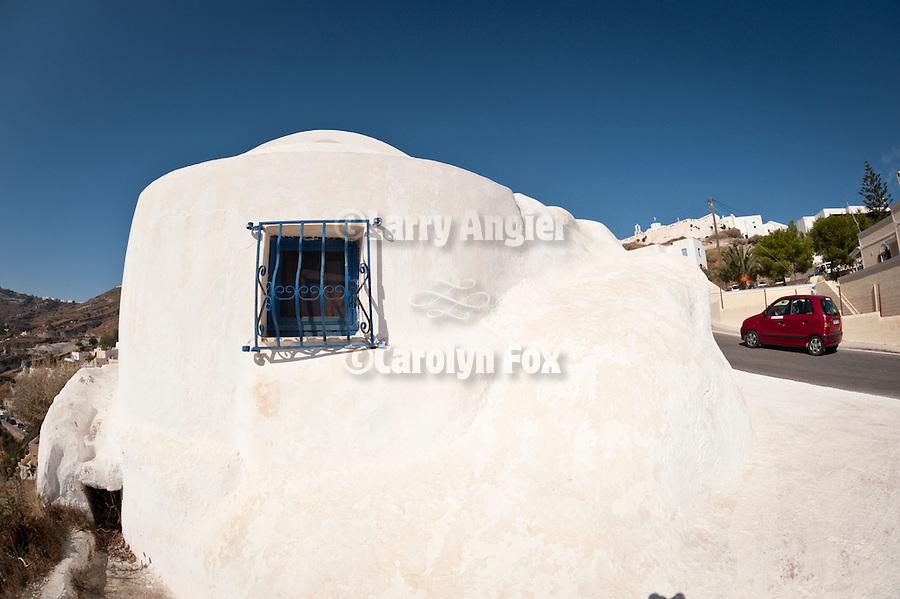Amorphous chapel along the road, Exo Gonia, Santorini, Greece.