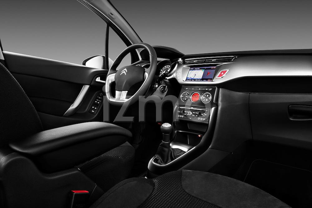 Straight dashboard view of a 2010 Citroen C3 Exclusive 5 Door Hatchback.