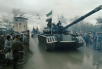 Tanks from warlord Ahmad Shah Massoud, going to the South Kabul Taleban front, from the Bagrham Airport next to Charikar city.