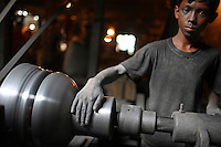 13 year old Liyakot Ali works in a silver cooking pot factory in Old Dhaka. The children work 10 hour days in hazardous conditions, for a weekly wage of 200 taka (3 USD)..