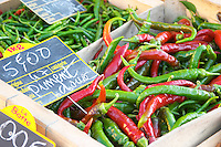 Pimiento pepper, pimento, chilli peppers red and green, for 5 euro per kilo, for sale at a market stall at the street market in Bergerac, Bergerac Dordogne France